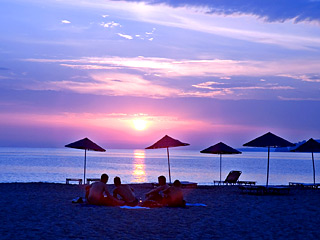 The sunset in the sandy beach of Plakias