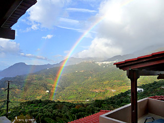 Winter Holidays in Crete - Amazing rainbow view from the apartments on a rainy Winter day