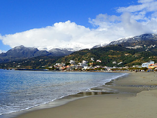 Winter Holidays in Crete - Plakias beach on a snow Winter day
